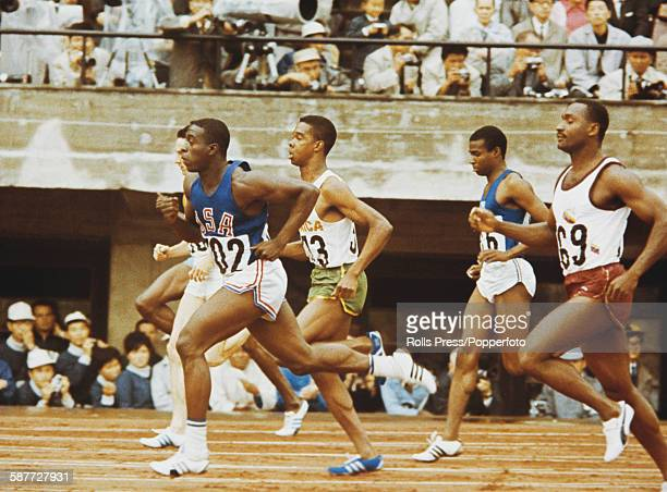 American athlete Bob Hayes pictured in action winning his semifinal race of the Men's 100 metres competition at the 1964 Summer Olympics in Tokyo...