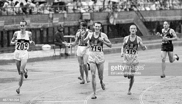 The final of the men's 5000 metres event featuring gold medallist Bob Schul of the United States silver medallist Harald Norpoth of Germany and...