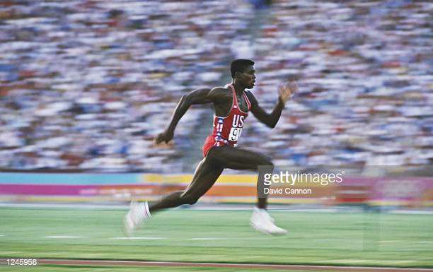 American athlete Carl Lewis accelerates down the runway as he competes in the Men's Long Jump event at the XXIII Olympic Summer Games at the Los...