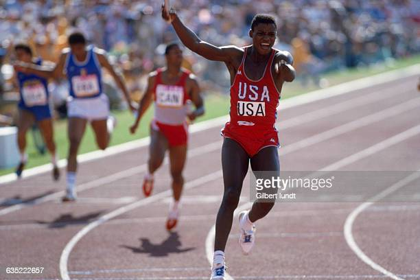 American athlete Carl Lewis celebrates after running the anchor leg for the gold medalwinning American 4 X 100 meter relay team at the 1984 Olympic...
