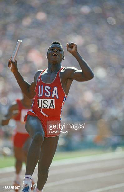 American athlete Carl Lewis crossing the line to win the final of the Men's 4 x 100 metres relay at the Los Angeles Memorial Coliseum during the...