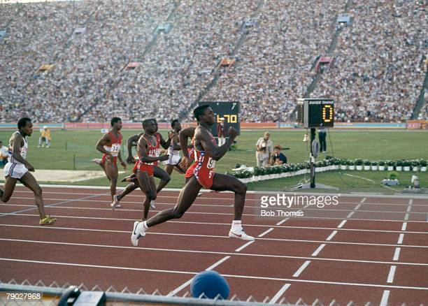 American athlete Carl Lewis finishes first with a time of 9.99 seconds to win the gold medal in the Men's 100 metres sprint event inside the Memorial...