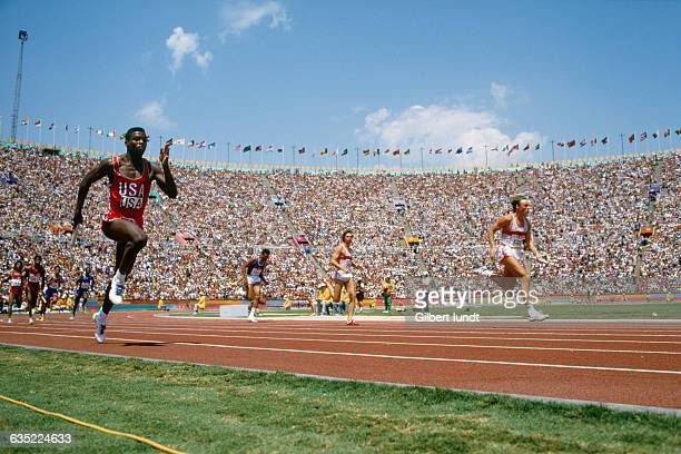 American athlete Carl Lewis runs in the final race for the men's 100meter relay at the 1984 summer Olympic Games