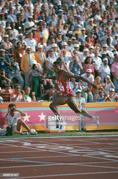 American athlete Carl Lewis winning the Men's 200 metres event at the Los Angeles Memorial Coliseum during the Olympic Games, Los Angeles, 8th August...