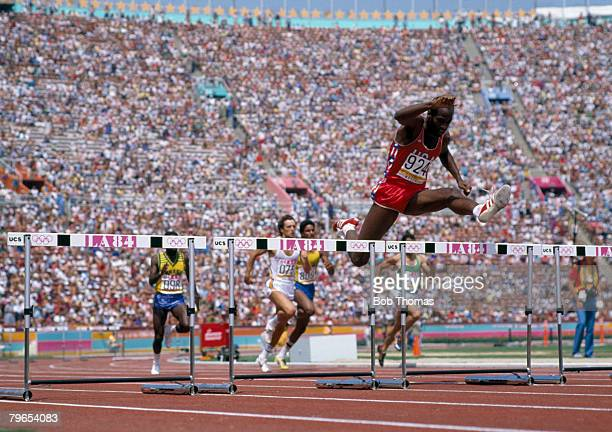 American athlete Edwin Moses pictured competing in the heats of the Men's 400 metres hurdles event inside the Memorial Coliseum at the 1984 Summer...