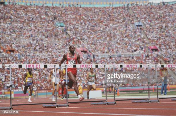 American athlete Edwin Moses of the United States team leads to finish in first place in heat 1 of the qualifying round of the Men's 400 metres...