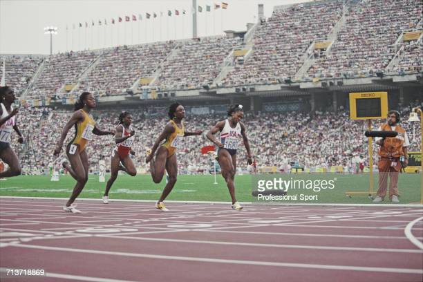 American athlete Gail Devers crosses the finish line in first place to win the gold medal for the United States ahead of from left Gwen Torrence of...