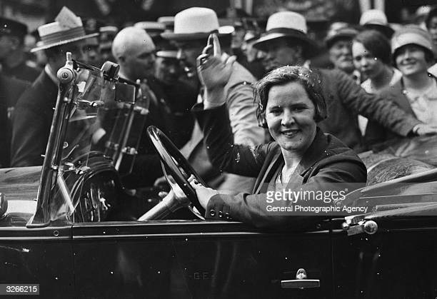American athlete Gertrude Ederle the first woman to swim the English Channel waves from a car circa 1926
