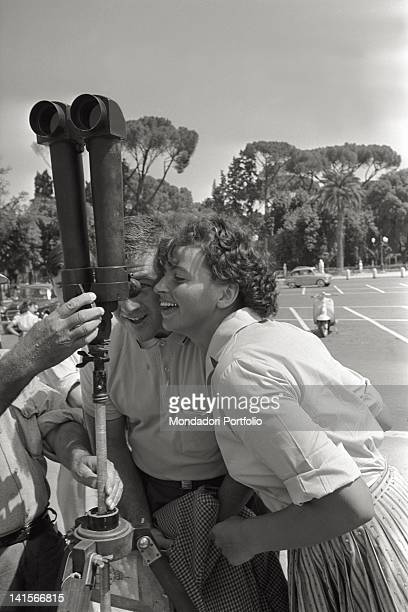 American athlete Harold Connolly and his wife the Czechoslovakian athlete Olga Fikotova watching the view through a pair of binoculars Rome 1960