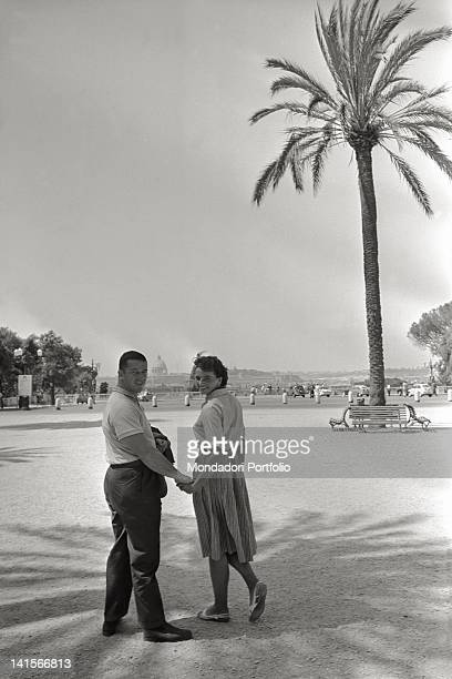 American athlete Harold Connolly walking hand in hand on the Pincian Hill with the Czechoslovakian athlete Olga Fitokova his wife Rome 1960