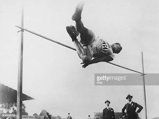 American athlete Harold Osborn clearing the high jump using the 'western roll' style at the Paris Olympics 1924 Osborne won the Olympic gold in the...