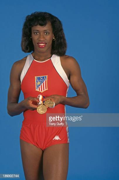 American athlete Jackie Joyner-Kersee holding the two gold medals she won in the heptathlon and long jump events at the Olympic Games in Seoul, circa...