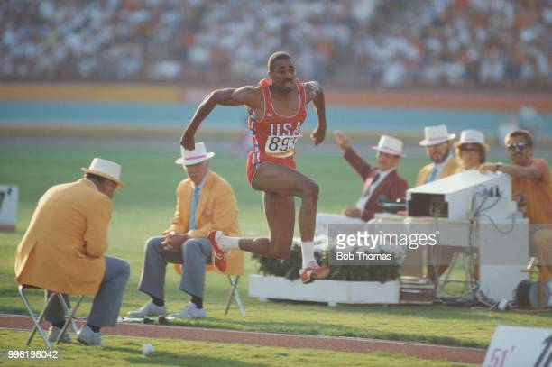 American athlete Mike Conley of the United States team pictured competing to finish in second place to win the silver medal in the Men's triple jump...