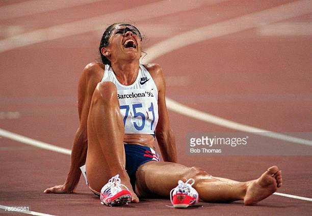 American athlete PattiSue Plumer of the United States team sits on the track with one running shoe removed after finishing in 5th place in the final...