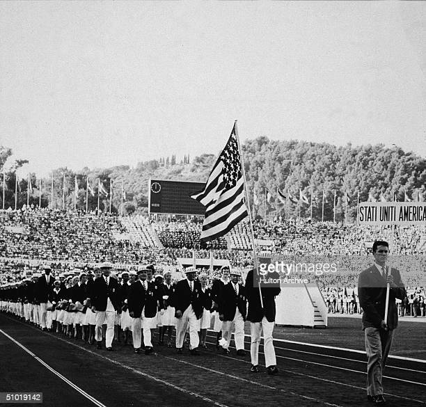 American athlete Rafer L Johnson leads his team and carries the American flag in the Olympic Stadium Rome Italy August 25 1960 Johnson went on to win...