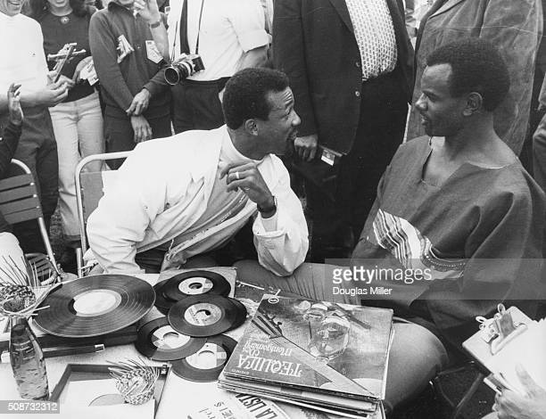 American athletes John Carlos the 200m record holder and Leon Cole the 110m hurdles record holder inspecting a music collection during a preOlympic...