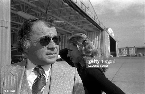 American attorney F Lee Bailey and his wife Lynda Hart stand on the tarmac near a hanger at an unidentified airfield San Francisco California 1976 At...