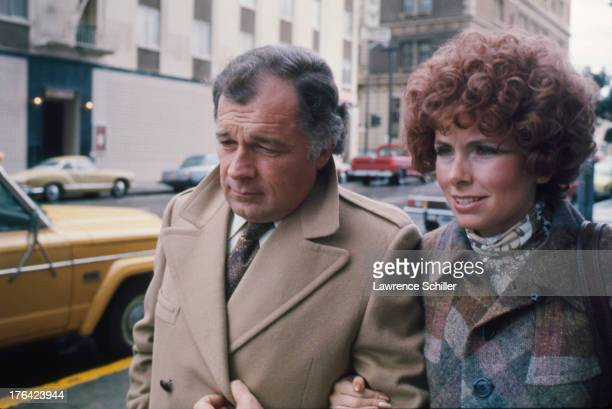 American attorney F Lee Bailey and his wife Lynda Hart walk arm in arm along a sidewalk San Francisco California 1976 At the time Bailey was serving...