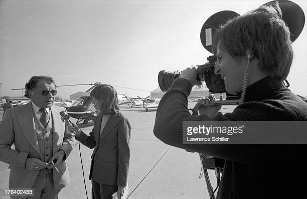 American attorney F Lee Bailey is filmed as he speaks with at journalist on the tarmac at an unidentified airfield San Francisco California 1976 At...