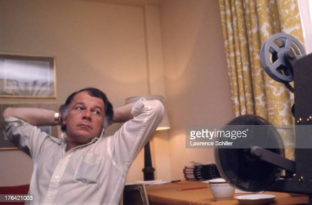 American attorney F Lee Bailey leans back in his chair his hands behind his head as he looks at a film projector San Francisco California 1976 At the...