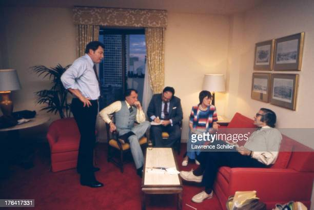 American attorney F Lee Bailey listens to a group of expert witnesses he assembled to help with his case for the defense during the trial of heiress...