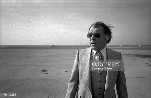 American attorney F Lee Bailey stands on the tarmac at an unidentified airfield San Francisco California 1976 At the time Bailey was serving as the...