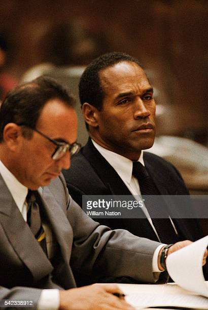 American attorney Robert Shapiro and his client, former football player, and actor O.J. Simpson during Simpson's trial for the murder of his wife...