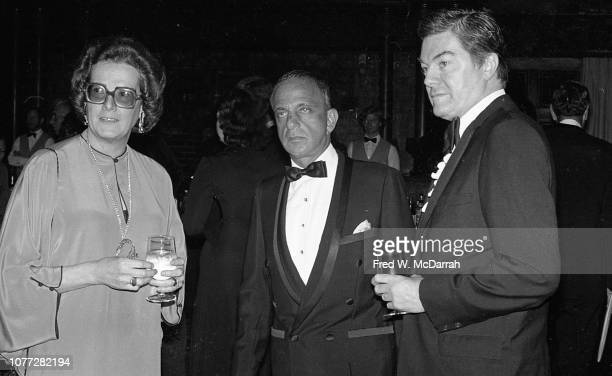 American attorney Roy Cohn poses with an unidentified woman and man during Cohn's birthday party at the Seventh Regiment Armory , New York, New York,...