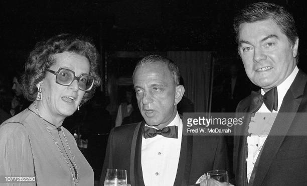 American attorney Roy Cohn poses with an unidentified woman and man during Cohn's birthday party at the Seventh Regiment Armory New York New York...