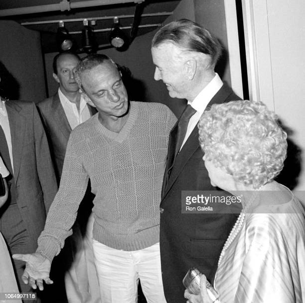 American attorney Roy Cohn poses with journalists and co-authors Earl Blackwell and Eugenia Sheppard as they attend the latter's 'Skyrocket' book...