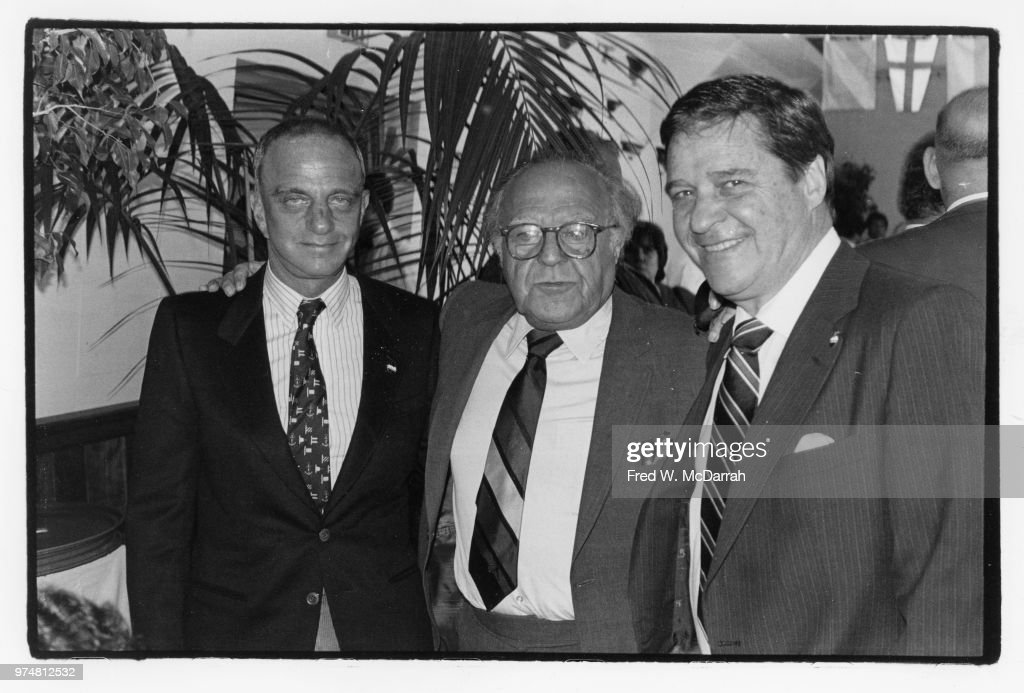 American attorney Roy Cohn (1927 - 1986) (right) poses with two unidentified men during a Citymeals-on-Wheels Restaurant Week benefit at the Water Club (at 500 East 30th Street), New York, New York, November 17, 1983.