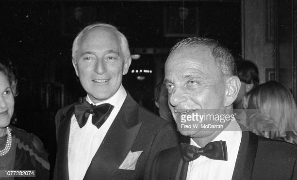 American attorney Roy Cohn smiles as he speaks with an unidentified people during his birthday party at the Seventh Regiment Armory New York New York...