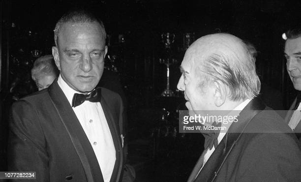 American attorney Roy Cohn speaks with an unidentified elderly man during Cohn's birthday party at the Seventh Regiment Armory New York New York...