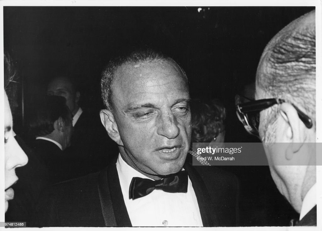 American attorney Roy Cohn (1927 - 1986) (center) speaks with an unidentified man during his birthday party at the Seventh Regiment Armory (aka Park Avenue Armory at 643 Park Avenue at 66th Street), New York, New York, February 22, 1981.