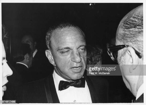 American attorney Roy Cohn speaks with an unidentified man during his birthday party at the Seventh Regiment Armory New York New York February 22 1981
