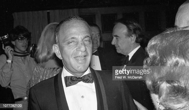 American attorney Roy Cohn speaks with an unidentified woman during his birthday party at the Seventh Regiment Armory New York New York February 22...