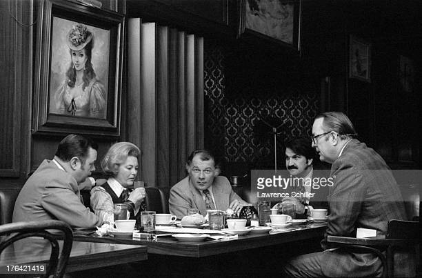 American attorneys F Lee Bailey and assistant J Albert Johnson sit on either side of University of California regent Catherine Hearst and across from...