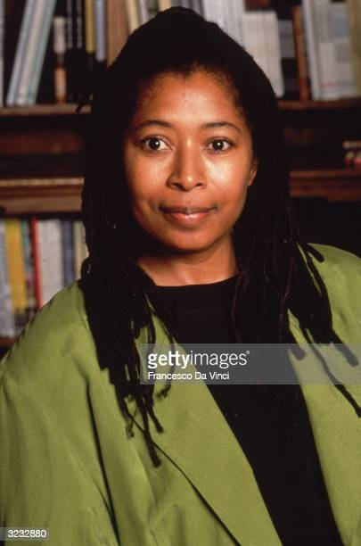 American author Alice Walker posing in front of a bookcase