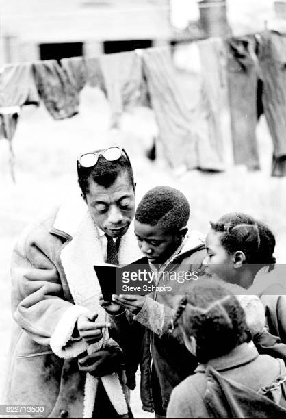 American author and activist James Baldwin reads a book with a group of children Durham North Carolina 1963