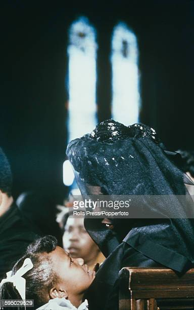 American author and civil rights leader Coretta Scott King pictured wearing a black veil as she attends the funeral ceremony for her husband Martin...