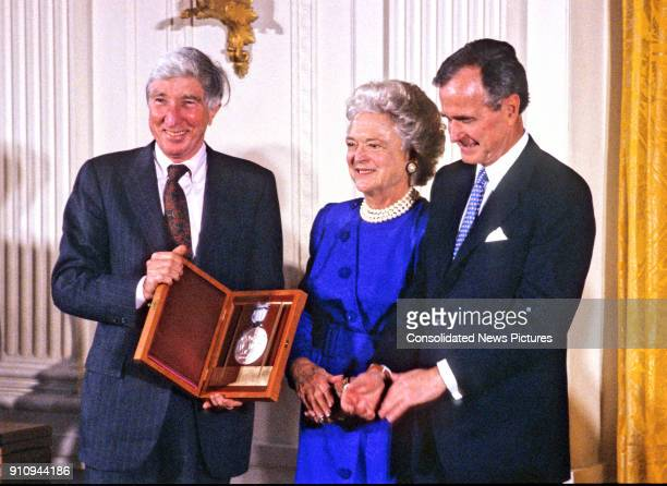 American author and critic John Updike is awarded the National Medal of Arts by US First Lady Barbara Bush and President George HW Bush during a...