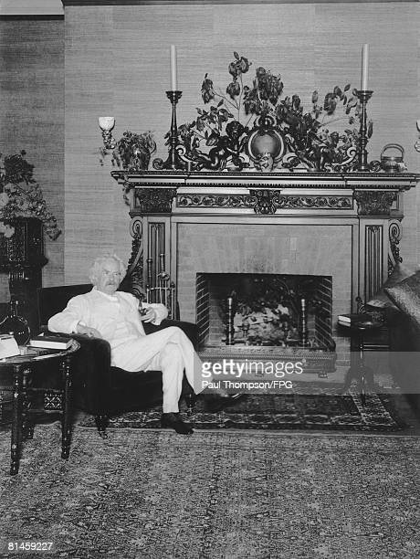 American author and humorist Samuel Langhorne Clemens better known as Mark Twain in the library of Stormfield his home in Redding Connecticut 1909...