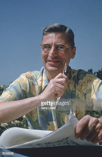 American author and illustrator Dr Seuss sits with pen and paper as he works on his book 'How the Grinch Stole Christmas' by his pool in La Jolla...