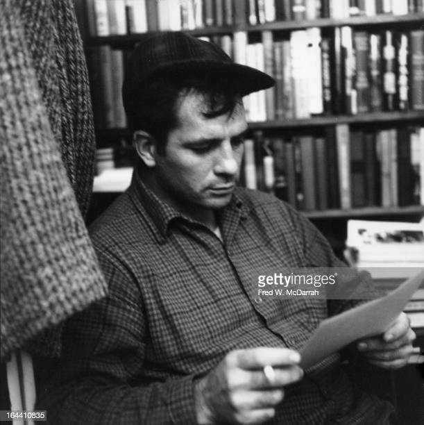 American author and poet Jack Kerouac contemplates a poem at the apartment of photographer McDarrah and his soontobe wife Gloria New York New York...