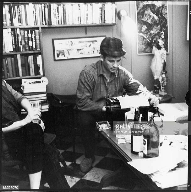 American author and poet Jack Kerouac types a poem at the apartment of photographer McDarrah and his soontobe wife Gloria New York New York December...