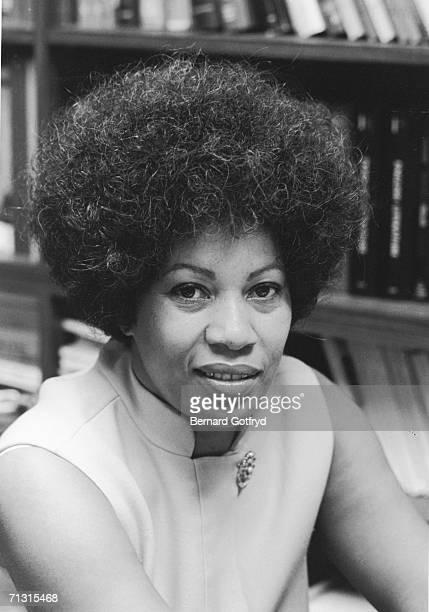 American author and winner of the Nobel Prize for Literature Toni Morrison sits and poses for a portrait in front of a bookshelf full of books she is...