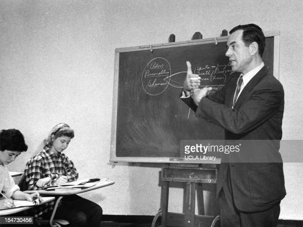 American author educator and mythologist Joseph Campbell gestures as he stands beside a chalk board and teaches a class at Sarah Lawrence College...