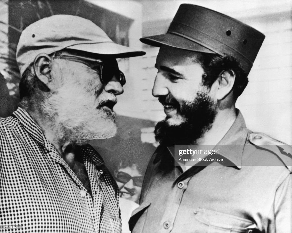 American author Ernest Hemingway (1899 - 1961) (left) in conversation with Cuban Premier Fidel Castro, Cuba, late 1959. In 1960 Hemingway was forced out of his home in Cuba due to the escalating tensions surrounding the Castro regime and moved to Idaho.