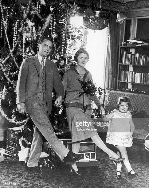 American author F Scott Fitzgerald dances with his wife Zelda Fitzgerald and daughter Frances in front of the Christmas tree in Paris.