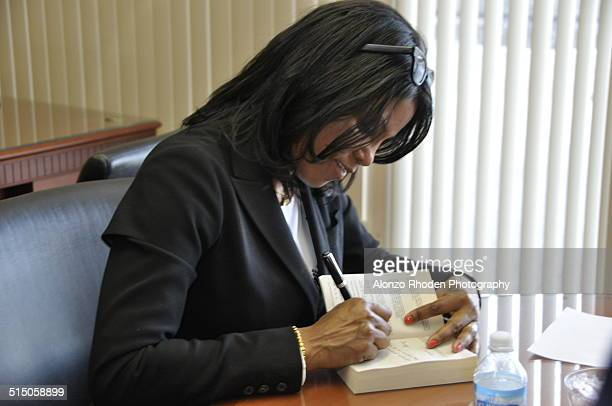 American author Ilyasah Shabazz signs a copy of her autobiography 'Growing Up X' at Malcolm X College Chicago Illinois April 9 2010 The book covers...